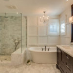 marble bathroom with white wall and oval bathtub