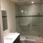 beautiful bathroom shower remodel with single dark brown vanity