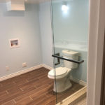 corner glass shower bathroom remodel with laundry
